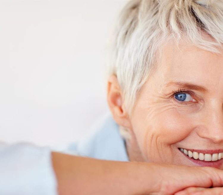 lady smiling after dental implant treatment